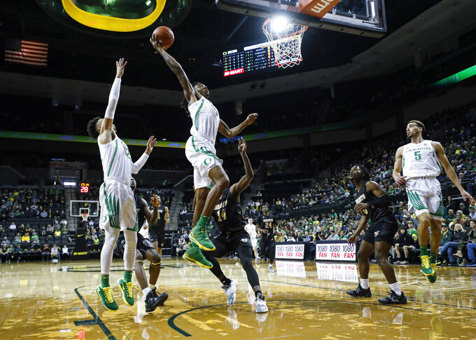 Oregon forward C.J. Walker (14), dunks against Alabama State during the first half of an NCAA college basketball game Sunday, Dec. 29, 2019, in Eugene, Ore. (AP Photo/Thomas Boyd)