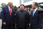 """FILE - In this June 30, 2019, file photo, President Donald Trump, left, meets with North Korean leader Kim Jong Un and South Korean President Moon Jae-in, right, at the border village of Panmunjom in the Demilitarized Zone, South Korea. North Korea on Saturday, June 13, 2020 again bashed South Korea, telling its rival to stop """"nonsensical"""" talk about its denuclearization and vowing to expand its military capabilities. (AP Photo/Susan Walsh)"""