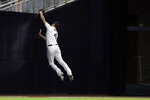 San Diego Padres left fielder Wil Myers hits the wall after making the catch for the out on Tampa Bay Rays' Ji-Man Choi during the fifth inning of a baseball game Tuesday, Aug. 13, 2019, in San Diego. (AP Photo/Gregory Bull)