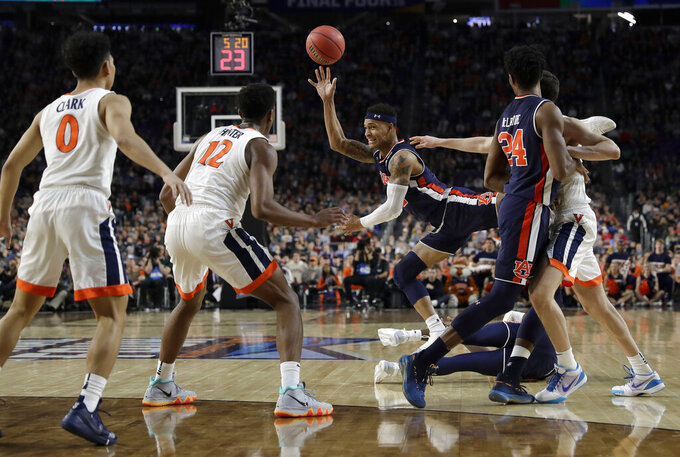 Auburn's Bryce Brown drives during the first half in the semifinals of the Final Four NCAA college basketball tournament against Virginia, Saturday, April 6, 2019, in Minneapolis. (AP Photo/David J. Phillip)