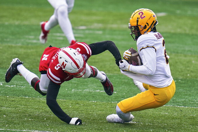 Nebraska safety Marquel Dismuke (9) tackles Minnesota's Philip Howard (2) during a punt return in first half of an NCAA college football game in Lincoln, Neb., Saturday, Dec. 12, 2020. (AP Photo/Nati Harnik)