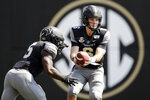 Vanderbilt quarterback Riley Neal (6) hands off to running back Ke'Shawn Vaughn (5) in the first half of an NCAA college football game against Northern Illinois Saturday, Sept. 28, 2019, in Nashville, Tenn. (AP Photo/Mark Humphrey)