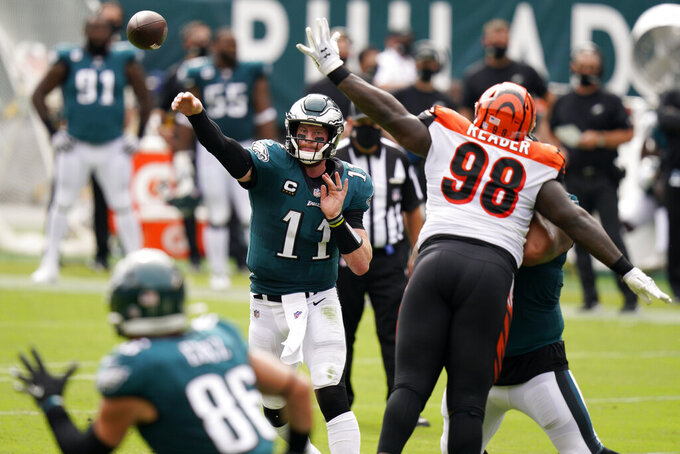 Philadelphia Eagles' Carson Wentz passes during the first half of an NFL football game against the Cincinnati Bengals, Sunday, Sept. 27, 2020, in Philadelphia. (AP Photo/Chris Szagola)