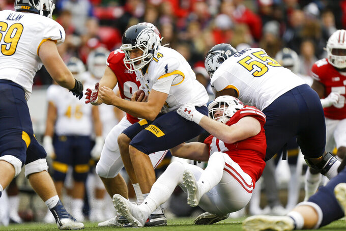 Wisconsin linebacker Noah Burks sacks Kent State quarterback Dustin Crum during the first half of an NCAA college football game Saturday, Oct. 5, 2019, in Madison, Wis. (AP Photo/Andy Manis)