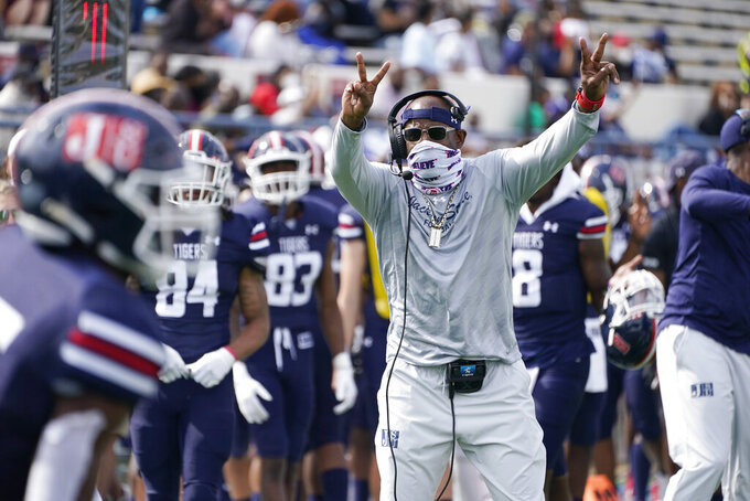 Jackson State football coach Deion Sanders gestures toward his team during the first half of an NCAA college football game against Mississippi Valley State, Sunday, March 14, 2021, in Jackson, Miss. (AP Photo/Rogelio V. Solis)