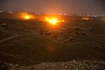 In this Monday, March 18, 2019, photo, Islamic State militant positions are ablaze in Baghouz, Syria as U.S-backed Syrian Democratic forces pound the group's remaining territory. On Tuesday, a spokesman for U.S.-backed forces fighting IS in Syria says his fighters are in control of an encampment in the village of Baghouz where IS militants have been besieged for months. (AP Photo/Maya Alleruzzo)