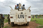FILE - In this Sunday, June 18, 2017 file photo, peacekeepers from the United Nations Mission in South Sudan (UNMISS) provide security during a visit of UNCHR High Commissioner Filippo Grandi to the U.N. Protection of Civilians camp in Bentiu, South Sudan. The United Nations peacekeeping mission in South Sudan said on Friday, Sept. 4, 2020 that it has begun withdrawing its troops and police from the protection of civilians camps that continue to shelter more than 180,000 people two years after the end of the country's civil war. (AP Photo/Sam Mednick, File)