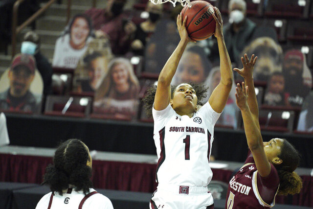 South Carolina guard Zia Cooke (1) attempts a shot over Charleston guard Madison Taylor (0) during the first half of an NCAA college basketball game Wednesday, Nov. 25, 2020, in Columbia, S.C. (AP Photo/Sean Rayford)