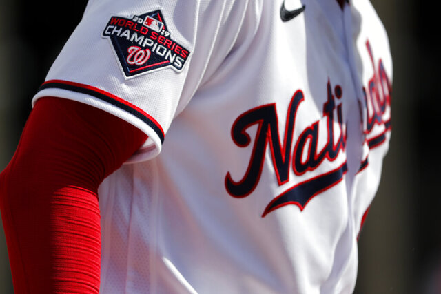 Washington Nationals pitcher Patrick Corbin wears a World Series Champions patch on his jersey while throwing a bullpen session during spring training baseball practice Monday, Feb. 17, 2020, in West Palm Beach, Fla. The Nationals defeated the Houston Astros in the World Series last season. (AP Photo/Jeff Roberson)