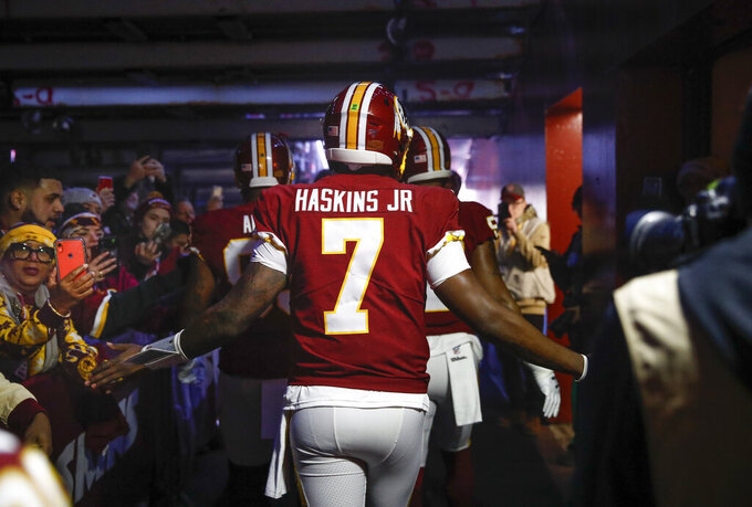 Washington Redskins quarterback Dwayne Haskins (7) greeting fans as he takes the field to start the first half of an NFL football game against the Philadelphia Eagles, Sunday, Dec. 15, 2019, in Landover, Md. (AP Photo/Patrick Semansky)