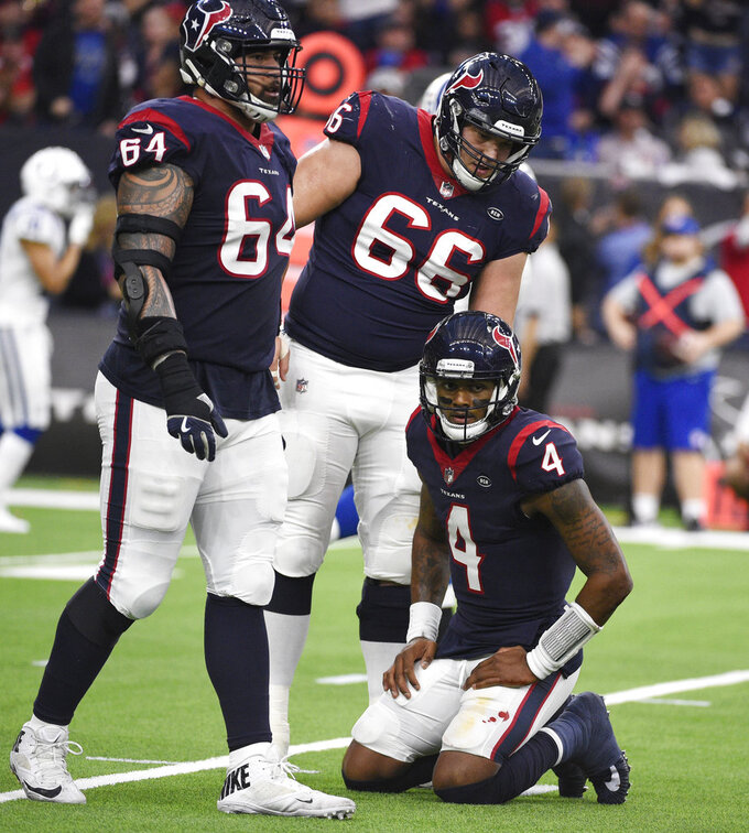 Houston Texans quarterback Deshaun Watson (4) kneels on the turf after he was stopped on a play during the first half of an NFL wild card playoff football game against the Indianapolis Colts, Saturday, Jan. 5, 2019, in Houston. (AP Photo/Eric Christian Smith)