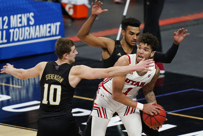 Washington's Erik Stevenson (10) and Jamal Bey guard Utah's Timmy Allen (1) during the second half of an NCAA college basketball game in the first round of the Pac-12 men's tournament Wednesday, March 10, 2021, in Las Vegas. (AP Photo/John Locher)