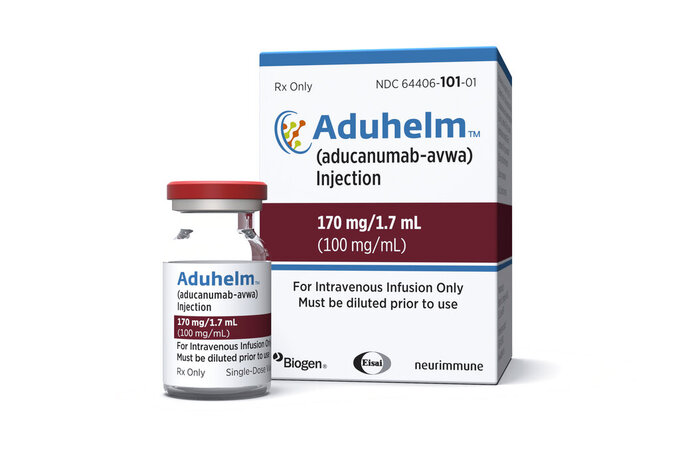 This image provided by Biogen on Monday, June 7, 2021 shows a vial and packaging for the drug Aduhelm. On Monday, June 7, 2021, the Food and Drug Administrationapproved Aduhelm, the first new medication for Alzheimer's disease in nearly 20 years, disregarding warnings from independent advisers that the much-debated treatment hasn't been shown to help slow the brain-destroying disease. (Biogen via AP)