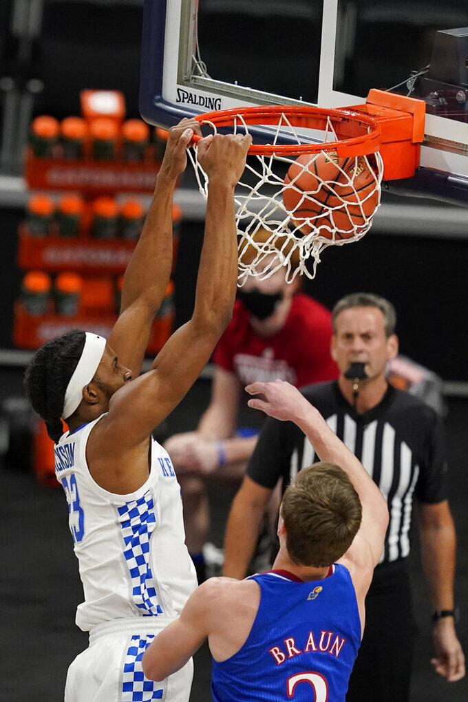 Kentucky's Isaiah Jackson (23) dunks against Kansas' Christian Braun (2) during the first half of an NCAA college basketball game Tuesday, Dec. 1, 2020, in Indianapolis. (AP Photo/Darron Cummings)