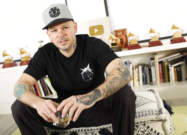 FILE - In this Friday, July 12, 2019 photo, rapper, writer, and filmmaker Rene Perez Joglar, know professionally as Residente, poses for a portrait in New York.  Residente, the most decorated winner in the history of Latin Grammys, has signed a multi-year deal with Sony Music Entertainment to launch 1868 Studios. (Photo by Brian Ach/Invision/AP, File)