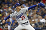 Los Angeles Dodgers starting pitcher Walker Buehler (21) throws during the first inning of Game 7 of the National League Championship Series baseball game against the Milwaukee Brewers Saturday, Oct. 20, 2018, in Milwaukee. (AP Photo/Jeff Roberson)