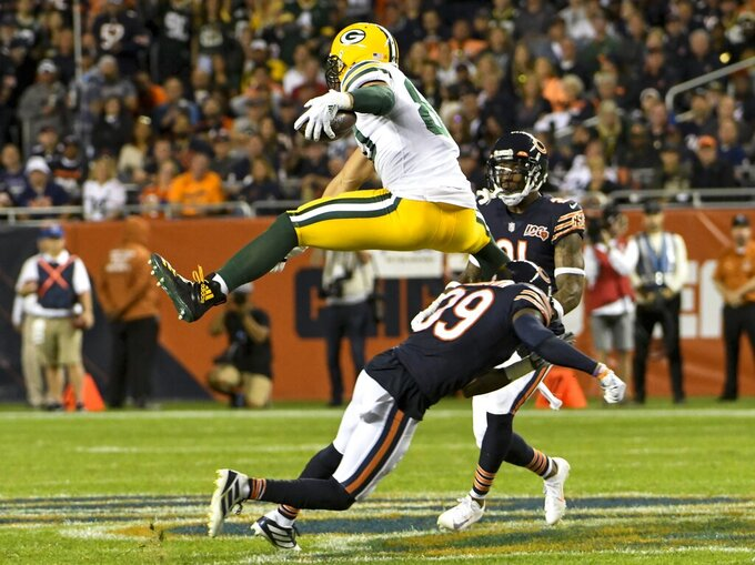 Green Bay Packers' Jimmy Graham leaps over Chicago Bears' Eddie Jackson during the first half of an NFL football game Thursday, Sept. 5, 2019, in Chicago. (AP Photo/David Banks)