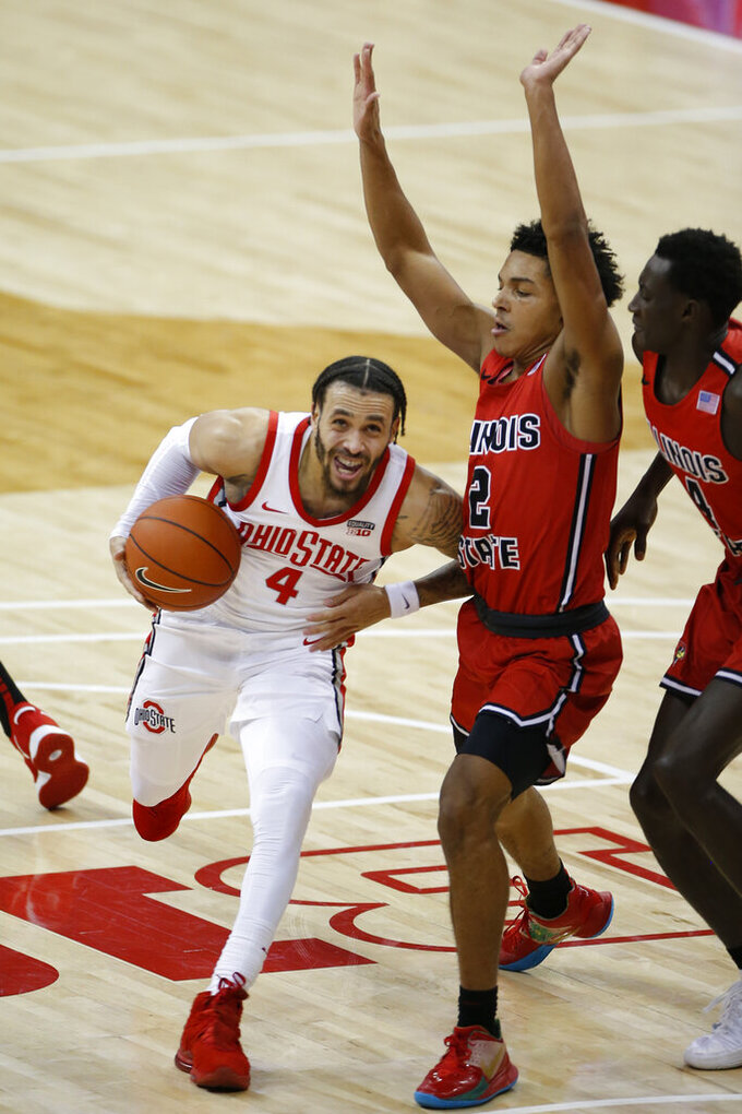 Ohio State's Duane Washington, left, drives to the basket against Illinois State's Josiah Strong during the first half of an NCAA college basketball game Wednesday, Nov. 25, 2020, in Columbus, Ohio. (AP Photo/Jay LaPrete)