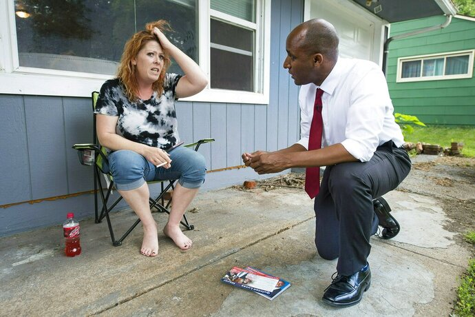 In a Thursday, May 30, 2019 photo, Sonja Houston expressed dismay that someone dumped a large pile of trash in her yard to Kansas City mayoral candidate Quinton Lucas, who was going door-to-door in the Ruskin Heights neighborhood. Quinton faces Jolie Justus in the mayoral election Tuesday, June 18, 2019.  (Tammy Ljungblad/The Kansas City Star via AP)
