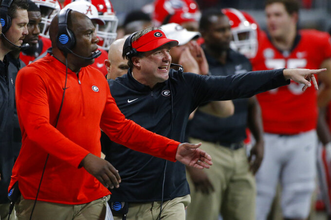 Georgia defensive coordinator Mel Tucker and Georgia coach Kirby Smart on the sideline in the second half of the Southeastern Conference Championship game between Georgia and Alabama in Atlanta, Saturday, Dec. 1, 2018. Georgia lost 35-28. (Joshua L. Jones/Athens Banner-Herald via AP)/Athens Banner-Herald via AP)