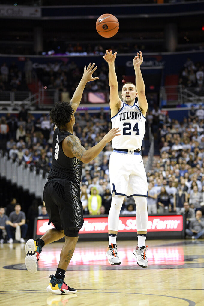 Villanova guard Joe Cremo (24) shoots against Georgetown guard James Akinjo (3) during the first half of an NCAA college basketball game, Wednesday, Feb. 20, 2019, in Washington. (AP Photo/Nick Wass)