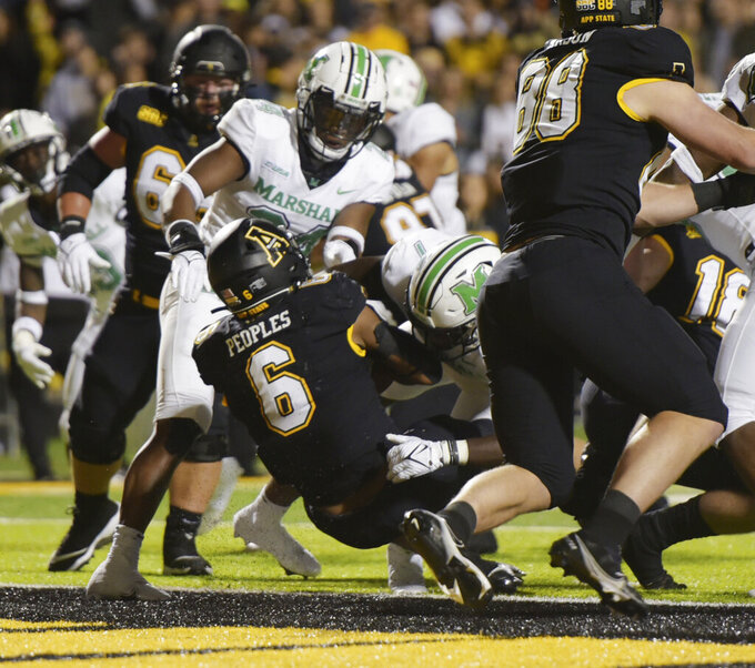 Appalachian State running back Camerun Peoples (6) scores his second of three first half touchdowns against Marshall in an NCAA college football game, Thursday, Sept. 2, 2021 at Kidd Brewer Stadium in Boone, N.C. (Walt Unks/The Winston-Salem Journal via AP)