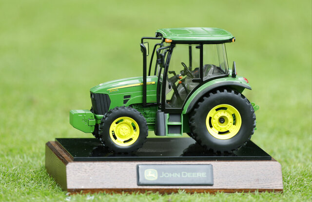 FILE - In this Saturday, July 13, 2013 file photo, A John Deere tractor tee marker is seen during the third round of the John Deere Classic golf tournament at TPC Deere Run in Silvis, Ill.  Officials decided Thursday, May 28, 2020 to cancel this year's tournament. (AP Photo/Charlie Neibergall, File)