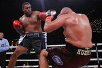 Michael Hunter, left, knocks down Russia's Sergey Kuzmin during the fifth round of a heavyweight boxing match Friday, Sept. 13, 2019, in New York. Hunter won the fight. (AP Photo/Frank Franklin II)