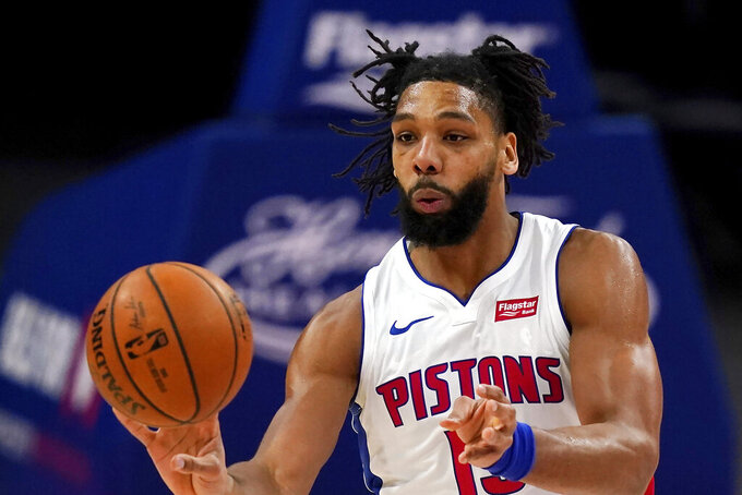 FILE - In this Dec. 11, 2020, file photo, Detroit Pistons center Jahlil Okafor passes the ball during the first half of a preseason NBA basketball game in Detroit. The Detroit Pistons acquired veteran center DeAndre Jordan in a multiplayer trade with the Brooklyn Nets on Saturday, Sept. 4, 2021. The Pistons also received four second-round picks and cash considerations from the Nets in exchange for forward Sekou Doumbouya and center Jahlil Okafor. (AP Photo/Carlos Osorio, File)