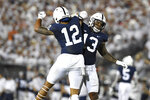Penn State linebackers Brandon Smith (12) and Ellis Brooks (13) celebrate a stop against Auburn during an NCAA college football game in State College, Pa., on Saturday, Sept. 18, 2021. (AP Photo/Barry Reeger)