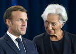 New European Central Bank President Christine Lagarde looks at French President Emmanuel Macron, at a ceremony celebrating the change at the head of the ECB in Frankfurt, Germany, Monday, Oct. 28, 2019. Mario Draghi leaves as head of the European Central Bank credited with having rescued the eurozone from disaster with a well-timed phrase and bold action to back up his words. (Boris Roessler/Pool Photo via AP)