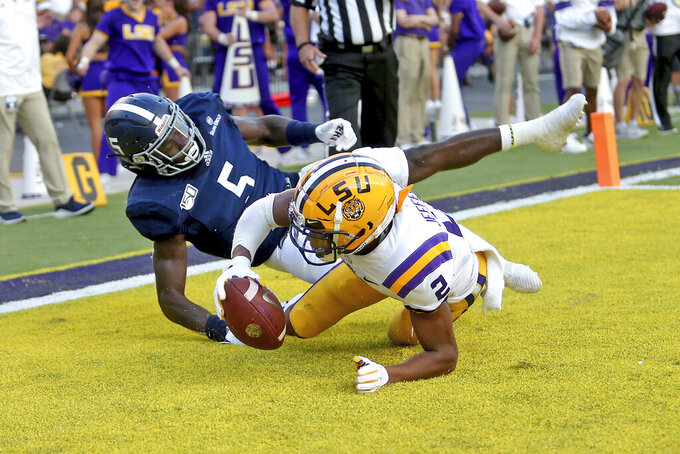 LSU wide receiver Justin Jefferson (2) catches a 9-yard touchdown as Georgia Southern linebacker Jay Bowdry (5) defends in the first quarter of an NCAA college football game in Baton Rouge, La., Saturday, Aug. 31, 2019. (AP Photo/Michael Democker)