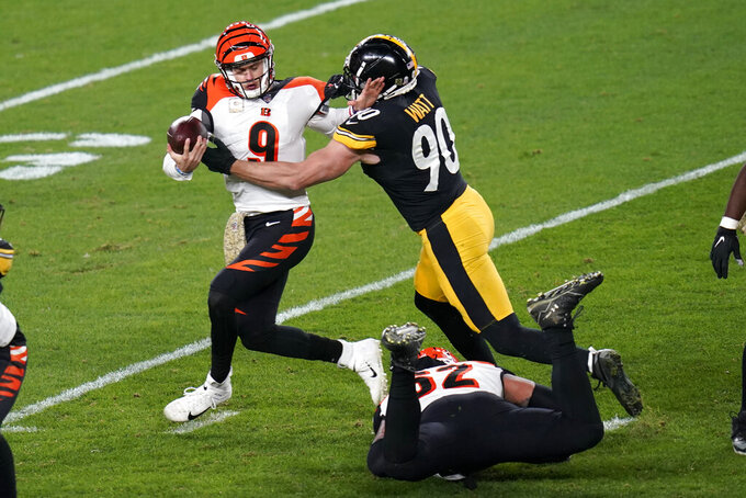 Cincinnati Bengals quarterback Joe Burrow (9) is sacked by Pittsburgh Steelers outside linebacker T.J. Watt (90) during the first half of an NFL football game, Sunday, Nov. 15, 2020, in Pittsburgh. (AP Photo/Keith Srakocic)