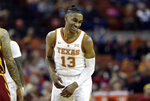 Texas guard Jase Febres (13) celebrates after a play during the second half of an NCAA college basketball game against Iowa State, Saturday, March 2, 2019, in Austin, Texas. (AP Photo/Eric Gay)