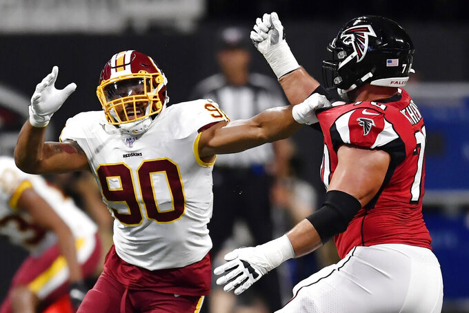 Washington Redskins linebacker Montez Sweat (90) works against Atlanta Falcons offensive tackle Jake Matthews (70) during the first half an NFL preseason football game, Thursday, Aug. 22, 2019, in Atlanta. (AP Photo/Mike Stewart)