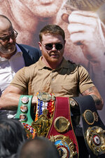 Unified WBC/WBO/WBA super middleweight champion Canelo Alvarez poses with his belts during a news conference Tuesday, Sept. 21, 2021, in Beverly Hills, Calif. to announce his 168-pound title bout against undefeated IBF Super Middleweight Champion Caleb Plant. The fight is scheduled for Saturday, Nov. 6 in Las Vegas. (AP Photo/Mark J. Terrill)