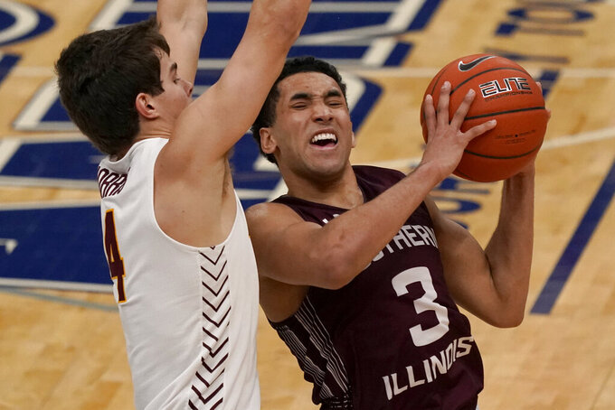 Southern Illinois' Dalton Banks (3) heads to the basket as Loyola of Chicago's Braden Norris defends during the first half of an NCAA college basketball game in the quarterfinal round of the Missouri Valley Conference men's tournament Friday, March 5, 2021, in St. Louis. (AP Photo/Jeff Roberson)