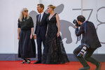 Jane Campion, from left, Benedict Cumberbatch and Kirsten Dunst pose for photographers on the red carpet of the film 'The Power Of The Dog' at the 78th edition of the Venice Film Festival in Venice, Italy, Thursday, Sep, 2, 2021. (AP Photo/Domenico Stinellis)