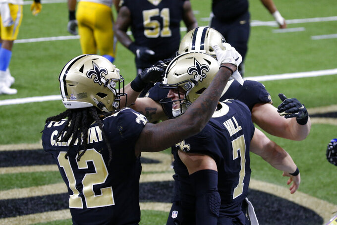 New Orleans Saints quarterback Taysom Hill (7) celebrates his touchdown with wide receiver Marquez Callaway (12) in the second half of an NFL football game against the Los Angeles Chargers in New Orleans, Monday, Oct. 12, 2020. (AP Photo/Butch Dill)