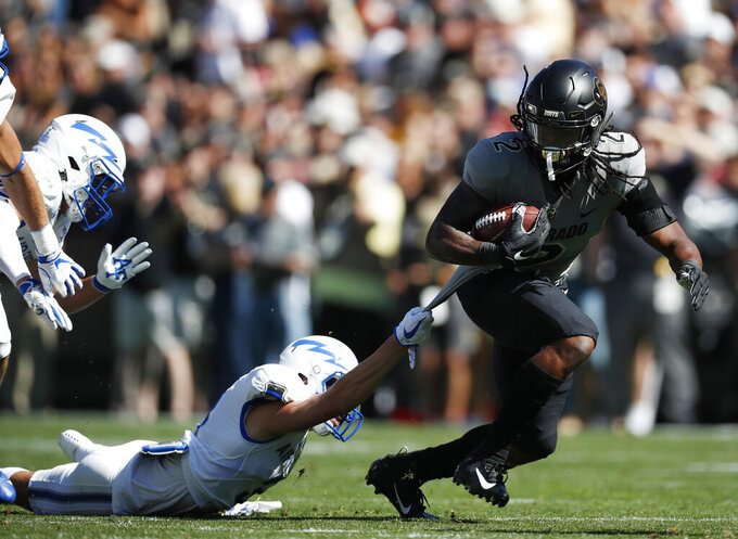 Air Force defensive back Milton Bugg III, left, tries to pull down Colorado wide receiver Laviska Shenault Jr. after he caught a pass in the first half of an NCAA college football game Saturday, Sept. 14, 2019, in Boulder, Colo. (AP Photo/David Zalubowski)