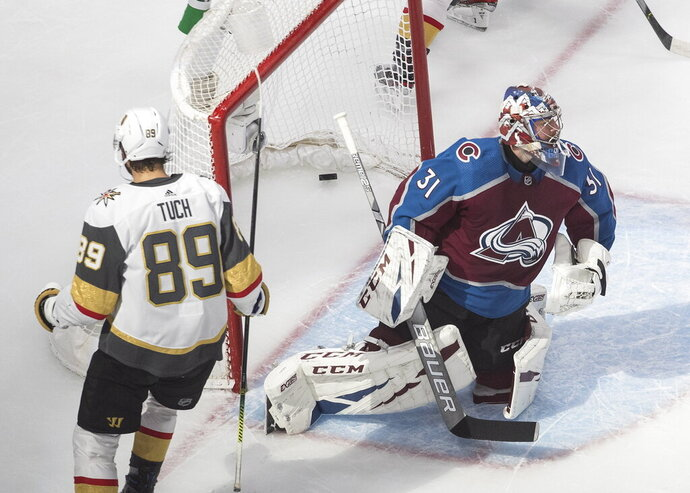CORRECTS TO OVERTIME, INSTEAD OF THIRD PERIOD - Colorado Avalanche goalie Philipp Grubauer (31) gives up a goal to Vegas Golden Knights' Alex Tuch (89) during overtime in an NHL hockey playoff game in Edmonton, Alberta, Saturday, Aug. 8, 2020. (Jason Franson/The Canadian Press via AP)
