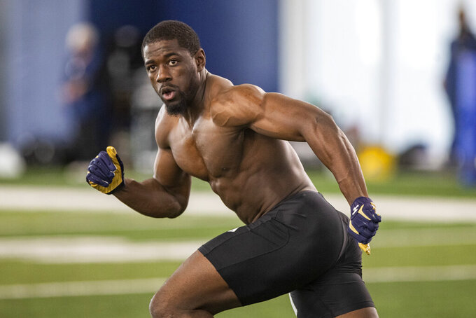 "FILE - Jeremiah Owusu-Koramoah participates in Notre Dame's Pro Day workout in South Bend, Ind., in this Wednesday, March 31, 2021, file photo. Browns rookie linebacker Jeremiah Owusu-Koramoah said he's not worried about a heart issue that may have caused some teams to pass on him in the NFL draft. ""My heart is 100% healthy,"" Owusu-Koramoah said Friday, May 14, 2021, on a Zoom call as the Browns opened rookie minicamp. (AP Photo/Robert Franklin, File)"