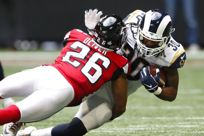 Los Angeles Rams running back Todd Gurley (30) runs into Atlanta Falcons cornerback Isaiah Oliver (26) during the first half of an NFL football game, Sunday, Oct. 20, 2019, in Atlanta. (AP Photo/John Bazemore)