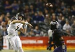California quarterback Chase Garbers (7) throws a pass over TCU linebacker Arico Evans, right, during the first half of the Cheez-It Bowl NCAA college football game Wednesday, Dec. 26, 2018, in Phoenix. (AP Photo/Ross D. Franklin)
