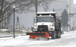 A City of Owensboro's truck clears snow from the roadway on northbound Frederica Street in Owensboro, Ky., on Monday, Feb. 15, 2021. (Alan Warren/The Messenger-Inquirer via AP)
