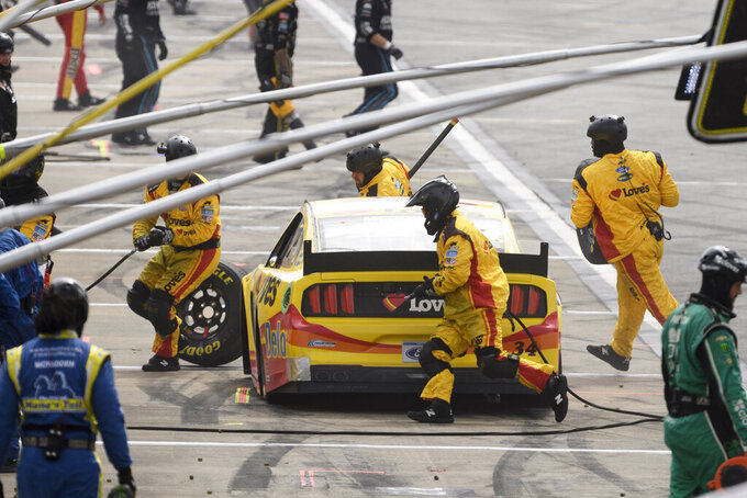 Michael McDowell makes a pit stop during a NASCAR Cup series auto race Monday, Oct. 4, 2021, in Talladega, Ala. (AP Photo/John Amis)