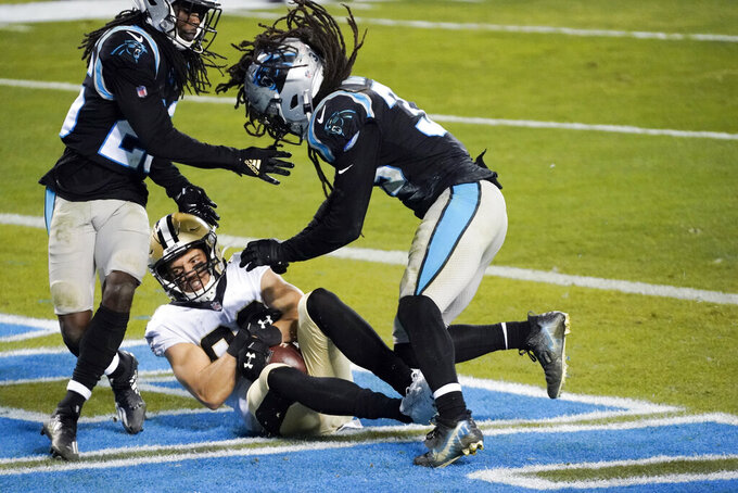 New Orleans Saints wide receiver Austin Carr scores between Carolina Panthers cornerback Donte Jackson and free safety Tre Boston during the second half of an NFL football game Sunday, Jan. 3, 2021, in Charlotte, N.C. (AP Photo/Gerry Broome)