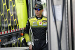 Kyle Busch heads to his garage during testing for the upcoming Rolex 24 hour auto race at Daytona International Speedway, Friday, Jan. 3, 2020, in Daytona Beach, Fla. (AP Photo/John Raoux)