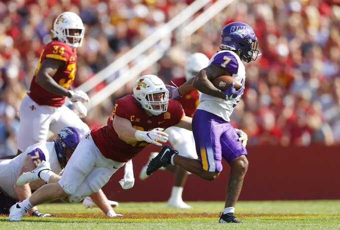 Northern Iowa running back Dom Williams (7) eludes a tackle by Iowa State linebacker Mike Rose (23) during the first half of an NCAA college football game, Saturday, Sept. 4, 2021, in Ames, Iowa. (AP Photo/Matthew Putney)