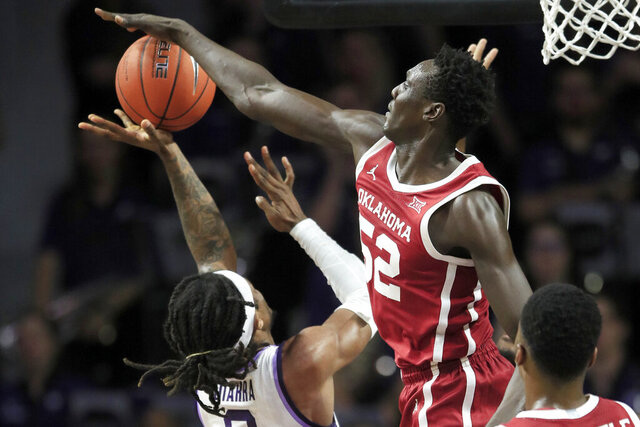 Oklahoma forward Kur Kuath (52) blocks a shot by Kansas State guard Cartier Diarra (2) during the first half of an NCAA college basketball game in Manhattan, Kan., Wednesday, Jan. 29, 2020. (AP Photo/Orlin Wagner)